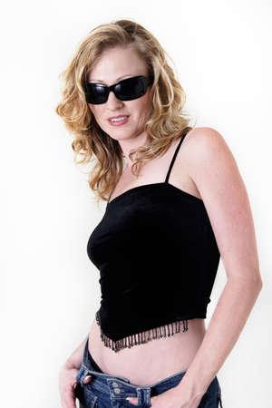 Attractive woman in black sunglasses on white in sexy attire photo