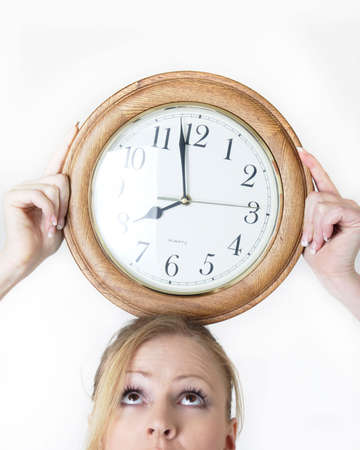 woman with a clock balanced on head showing time management Stock Photo - 305105