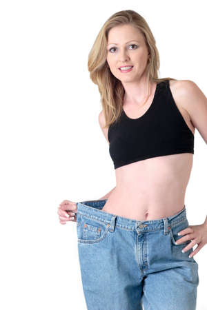 obtain: Woman demonstrating weight loss by wearing an old pair of jeans four sizes too big
