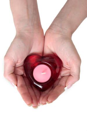 bougie coeur: les womans remet tenir une bougie de coeur dans elle des mains Banque d'images