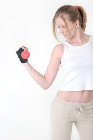 coordinacion: peso de elevaci�n del brazo de la mujer en blanco