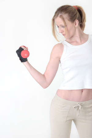 woman lifting arm weight on white