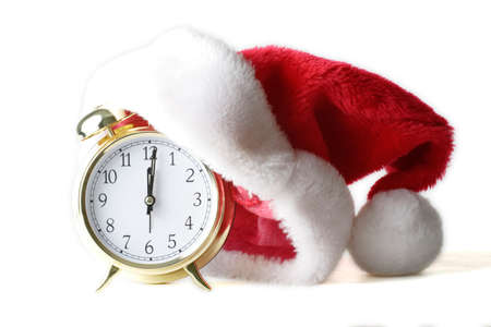 isolated alarm clock with santa hat to show Christmas time photo