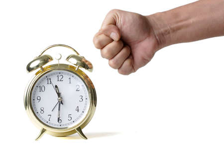 Man's fist about to hit a clock showing the concept of Punching the clock Stock Photo - 328219