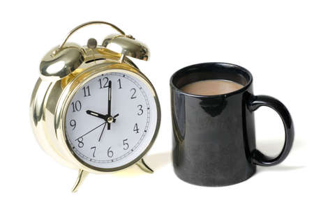 cup of coffee beside a clock to show Coffee time photo