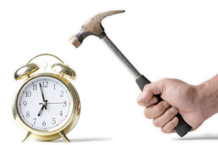 Hammer about to hit the alarm clock photo