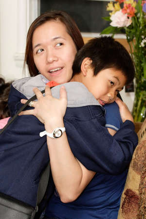boy giving mother or aunt a hug for a greeting photo