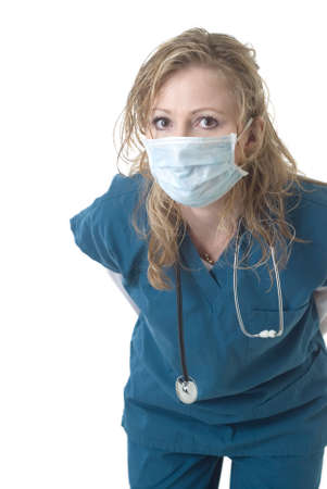 Attractive nurse wearing face mask leaning forward on white Banque d'images