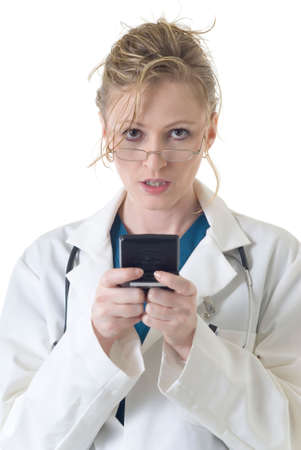 pager: Attractive lady doctor reading messages from 2 way pager