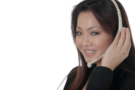Attractive Asian woman wearing head set Stock Photo