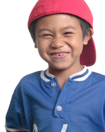 Cute happy boy in red baseball cap close up on white Stock Photo