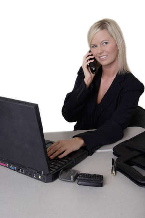 woman typing: Business woman typing and talking on the phone