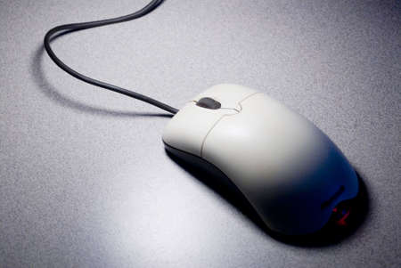 isolated Computer mouse in shadow Фото со стока