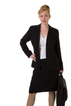 business woman with hand on hip carrying briefcase standing over white