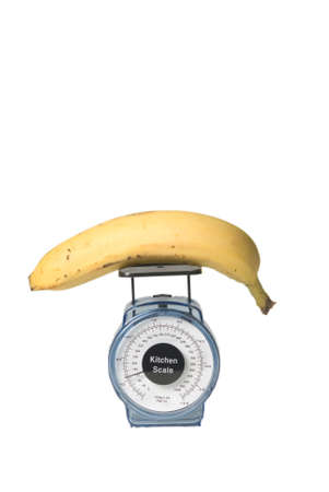 banana on a kitchen scale to illustrate balanced diet