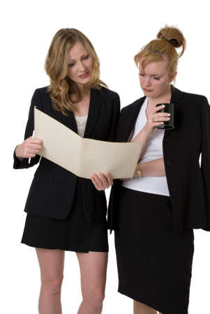 delegation: two business women standing looking at file or case Stock Photo