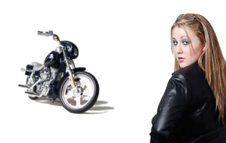 Attractive girl in leather with motorcycle isolated on white photo