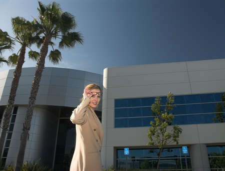 business woman standing outside office building photo
