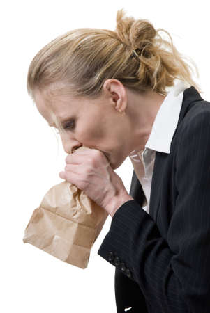 woman breathing into a brown paper bag photo