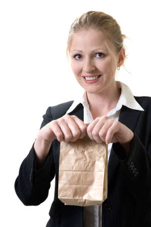 woman offering a brown bag lunch