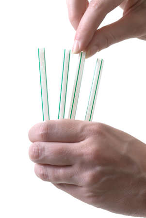 assign: drawing straws to demonstrate decision making Stock Photo