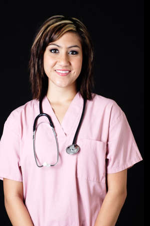 compassionate: Friendly nurse in pink scrubs with stethoscope Stock Photo