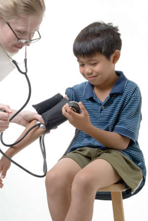 Young boy having his blood pressure checked