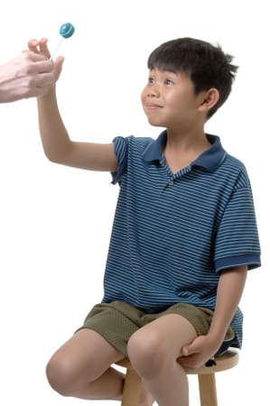 boy receiving his reward from the doctor Banco de Imagens