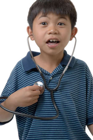 behave: Young boy trying to listen to his playing with a stethoscope