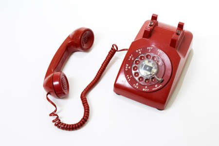 important phone call: isolated old style red phone off the hook on white Stock Photo