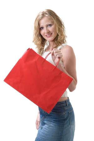 Woman advertising blank red shopping bag photo