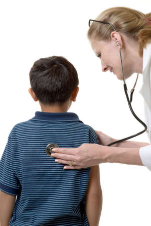 Young asian boy examined by caucasian woman doctor photo