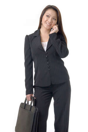 Attractive Asian Business woman talking on cell phone standing on white Stock Photo