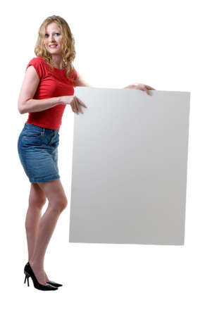 Woman holding blank sign standing on white photo