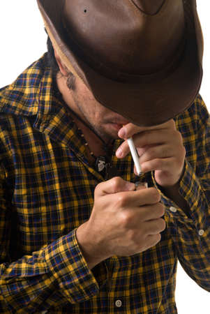 cowboy lighting a cigarette photo