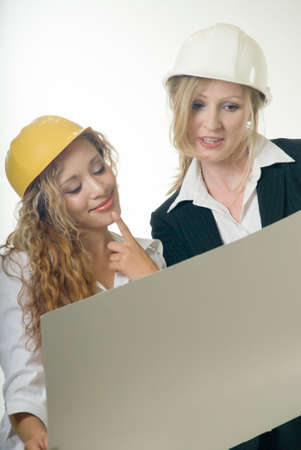 two lady architects working together holding plans Stock Photo - 524347