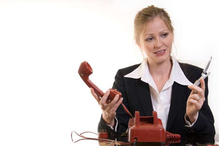 business woman comparing the old rotary phone with a modern cell phone
