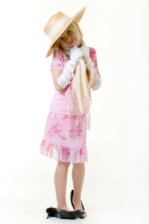 cute little eight year old girl wearing white gloves and too big high heeled shoes Stock Photo - 675634