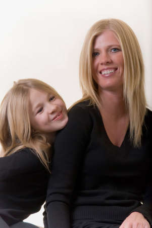 faces of attractive mother and eight year old daughter Stock Photo - 675637