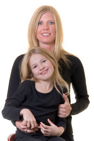 faces of attractive mother and eight year old daughter Reklamní fotografie