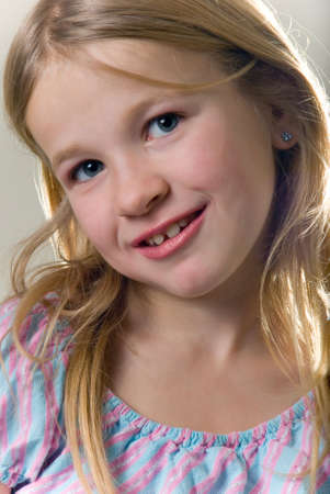 close up of face of a cute little blond eight year old girl Stock Photo - 702967