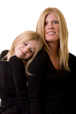 faces of attractive mother and eight year old daughter sitting together on white photo