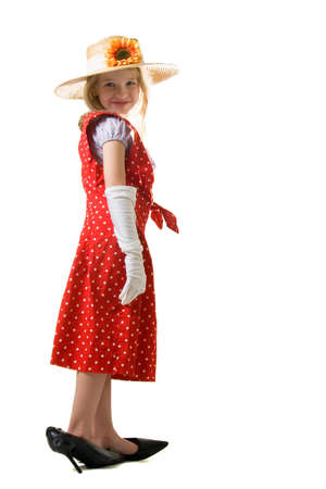 dressup: cute little eight year old girl wearing white gloves and too big high heeled shoes and large red polka dot dress