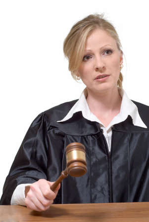 court judge: blond woman judge holding a gavel with serious expression over white background Stock Photo