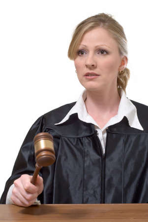 blond woman judge holding a gavel with serious expression over white background Stock Photo
