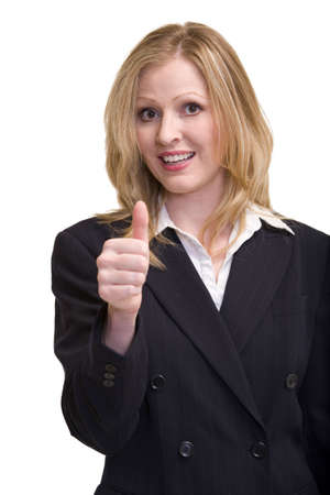 Attractive blonde woman in professional business suit standing on white smiling holding up and showing her thumb photo