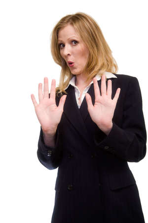 Attractive blonde woman in professional business suit standing on white with hands up in front of her and an offended expression on her face photo