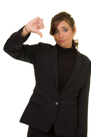 Attractive brunette woman in professional business suit standing on white pointing her thumb down Stock Photo - 877791