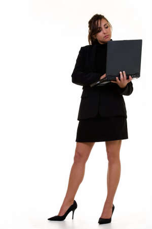 Attractive brunette smiling business woman holding up an open laptop computer showing the blank front screen looking confident standing on white Stock Photo - 877795