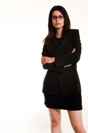 Full body of an attractive Armenian brunette business woman wearing eyeglasses in black business suit with arms crossed standing on white Stock Photo - 925091
